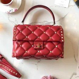 bd0275b28971 Camel Color Leather Handbag NZ - AAAAA Top qualit TOTE handbag 2018 NEW  rivets shoulder bag