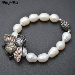 Fresh Water Pearl Charms NZ - Outstanding Paved CZ Metal Bee Insect Charm Natural Fresh Water Pearl Potato Beads Stretch Bracelets Party Jewelry