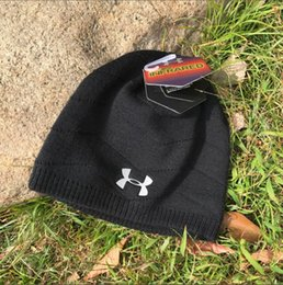2019 New UA Luxury brands Men and women autumn and winter soft warm hat  head covering ear protection knitted hat sports outdoor wool hat 3936e9fb590