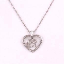 $enCountryForm.capitalKeyWord NZ - Beautiful Jewelry Women Necklace Heart Shape Cat Paw Print Pendant Design Suitable Birthday Gift Zinc Alloy Provide Dropshipping
