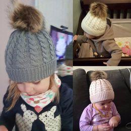 400fd0b619a Pompom Baby Cap twist Hair Ball Cap Children Solid Color Headgear Knit hat  Keep Warm Baby Soft Cute Hat Casquette Enfant Garcon
