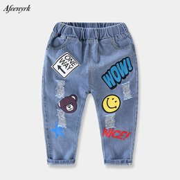 boys printed jeans NZ - High Quality Boys Girls Break Hole Jeans Long-style Kids Pockets Denim 2017 New Print Cartoon Bears Autumn Children Jeans Pants
