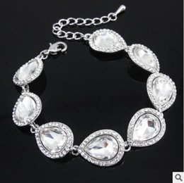 Venta al por mayor de Hot New Crystal Conjuntos de joyería nupcial Color de plata Lágrima Nupcial Pulsera Pendientes Establece Joyería de la boda Envío gratis