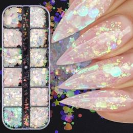 Venta al por mayor de 12 cuadrículas / set de uñas de arte de la sirena de las lentejuelas de Buttefly de la estrella de la luna del clavo de Paillette del brillo del clavo Claro Salon Tip