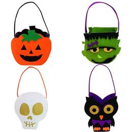 Cartoon Skull Children NZ - Halloween Tote Christmas bags cartoon pumpkin witch Skull Zombie Black cat Handbags 22*14cm 4 styles children candy Gifts Bags