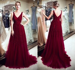 pictures celebrities NZ - Burgundy Sparkly Crystals Long Prom Dresses V Neck A Line Tulle Sequins Formal Evening Gowns Celebrity Red Carpet Fashion Wear CPS1178
