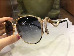 Nueva moda mujer diseñador gafas de sol 909 metal piloto animal marco piernas con forma de serpiente con diamantes gafas de protección de calidad superior 1109