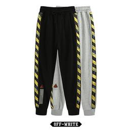 c6b73ad653f5 Pantaloni da uomo Hip Hop OFF Fashion Bianchi Pantaloni sportivi Zipper a  righe camouflage Pantaloni sportivi da uomo casual di alta qualità