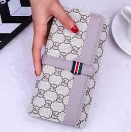 Venta al por mayor de Las mujeres de marca al por mayor que sostienen bolsas de gran capacidad de bloqueo carteras de teléfonos móviles de moda contrastan carteras de cuero multi-tarjeta impresa pared larga