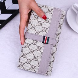 Wholesale brand women holding bags of large capacity lock mobile phone wallets fashion contrast leather wallets multi card printed long wall