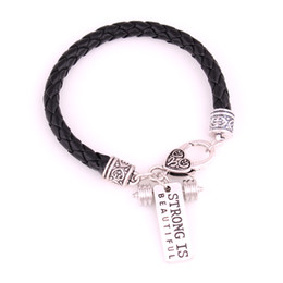 "China Apricot Fu White Black Leather Braided CrossFit Weight Lifting Fitness Dumbell Charm Bracelet ""Strong Is Beautiful"" suppliers"