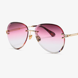 Chinese  luxury vintage rimless tinted oval sunglasses women's big clear round glasses gradient crystal sunglasses oculos de sol feminino manufacturers