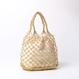 weaving cotton rope UK - Gold, silver 2color bright paper ropes hollow woven bag cotton lining straw bag female Reticulate handbag netted beach bag Y18102203