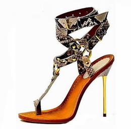 China Free Ship Gold Metal High Heel Sandals Woman Sexy Snakeskin T-bar Sandals Ring Buckle Strap Python Printed Leather Dress Shoes suppliers