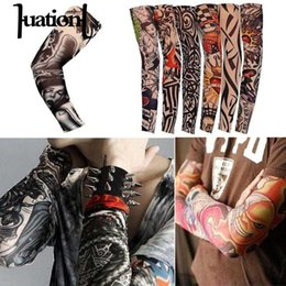 9c7c6c072e987 Huation 1PC Nylon Arm Warmer Women Men Tattoo Print Arm Sleeves 2018  Outdoor Sunscreen Tattoo Cover Elastic Bike Cycling Sleeves