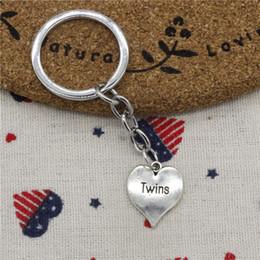 $enCountryForm.capitalKeyWord NZ - New fashion key chain heart twins 21*17mm pendant DIY male jewelry car key chain Holder Jewelry Gift Souvenirs