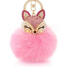 China KK Lovely Fox rabbit hair ball fluffy key ring ring crystal Hotsale handbag key chain key ring female models suppliers