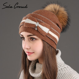 d379bf14 [Sole Crowd] Winter warm bow wool knitted hats women fashion pompom hats  made of natural real Raccoon fur caps female beanie hat