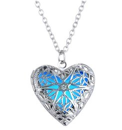 glow dark jewelry UK - New Style European and American fashion jewelry hearts hollow heart hollow glow-in-the-dark necklace luminous pendant fashion classic delica