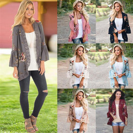 2ba7fe396c0 Spring Women Boho Floral Print Blouse New Bell Sleeve Hollow Out Lace  Patchwork Kimono Cardigan Femme Chiffon Tops
