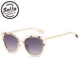 52e0ce1fd1716 Sella 2018 nouvelle arrivée tendances femmes évider alliage cadre lentille  lentille lunettes de soleil mode Cateye teinte lentille lunettes de soleil
