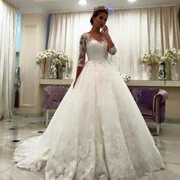 ArAbic queen online shopping - Queen Princess Dubai Half Sleeves A line Wedding Dresses Sheer Crew Neck Lace Appliques Arabic Bridal Gowns