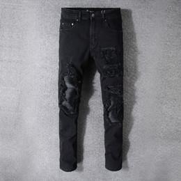 4e9fc78e5f7 2018 New famous luxury AMI Brand slim fit patchwork ri denim ripped zipper  NightClub punk style Hole biker skinny jeans Stretch for men 121
