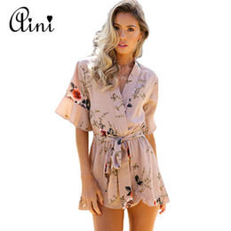 bdf37c8e68 WAQIA Boho Red Floral Print Ruffles Playsuits Women EleAutumn White V Neck Jumpsuits  Rompers Sexy Beach Girl Short Overalls