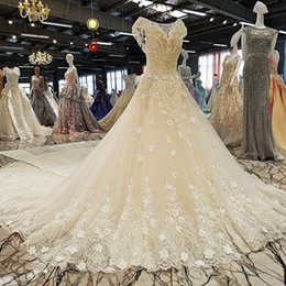 A-Line Wedding Dress O-Neck Beaded Cap Sleeves Backless Cathedral Train Luxury  Wedding Gowns Real Photos Real Pictures 862d1f57b001