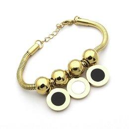 00ba69916d97 2018 joyas de acero de titanio al por mayor Blanco y negro tres bolas  redondas pulsera de hueso de serpiente pulsera de oro de comercio exterior  de 18 ...