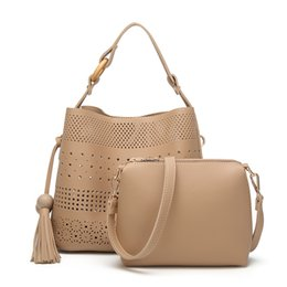 $enCountryForm.capitalKeyWord Canada - Women Leather Messenger Bags Bucket Type Tassels Mother Bag Korean Version Of The Leisure Carved Hollow Shoulder Bolsos Mujer