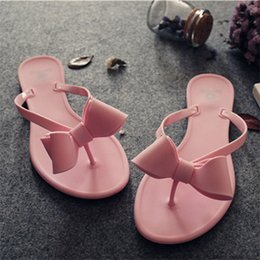 5a0257c12cad9c 2017 Summer Cold Slippers Women s Beach Shoes Pure Color Flip Flops Jelly  Shoes Butterfly Knot Flat with Outside Casual Novelty
