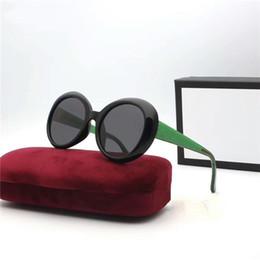 d7b6c62866 Marca de moda de lujo americana americana gafas de sol mujer mujer hombre  diseñador gafas de sol gafas de sol polarizadas ronda verde rojo azul gafas