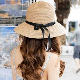 Wide Visor For Women Canada - Designer Women Wide Brimmed Beach Visors With Bow Garland Foldable Big Straw Hats For Women UA Protection Bohemia Summer Hat