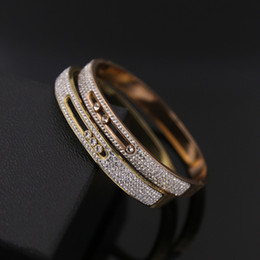 Inner Bezel Canada - Hot fashion French Paris titanium steel couple bracelets M letter three removable crystal ladies bracelet inner diameter 5.7cm