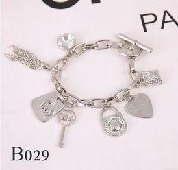 $enCountryForm.capitalKeyWord NZ - Hot! Alloy key bracelets with love heart sterling silver or gold plated pendants Charm Bracelets Bangle jewelry for men women B029