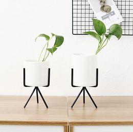 Vente en gros Pot de fleur charnue nordique vase en fer forgé simple cadre de fer stand de fleur pot de fleur hydroponique en céramique vert planteur ensemble