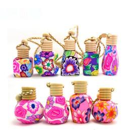 Venta al por mayor de Nuevo Llega el coche cuelga la decoración esencia de Cerámica botella de Perfume de aceite Botella colgante botella vacía envío gratis SN1458