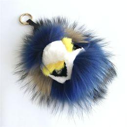 "$enCountryForm.capitalKeyWord NZ - 8"" Real Fur Monster Navy Blue Fur Triangle Eyes Bug bag Charm Ball Pom pom Keychain Keychain Backpack Tassels Pendant Handbag"