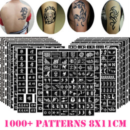 China 11cm*8cm 50pcs lot Temporary Glitter Tattoo Sticker Painting Stencils Drawing Airbrush Template Flash Body Art henna Women Men supplier henna sticker stencils suppliers