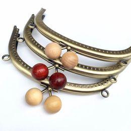kiss 10pcs Lot 16.5cm Bronze Metal Purse Frame Bags Handles for Coin Purses  Clutch Handbag Accessories Bag Kiss Clasp Lock c2ae0df4f15f