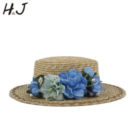05effd7ab45 Women Summer Wheat Straw Boater Hat Lady Beach Wide Brim Flat Sun Hat With Handmade  Flower Sunbonnet Size 56-58CM