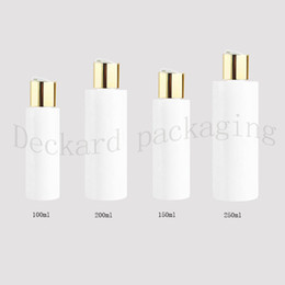 China 100 150 200 250ml empty white plastic shampoo bottles with gold disc caps,empty essential oils cosmetic packaging shower gel suppliers