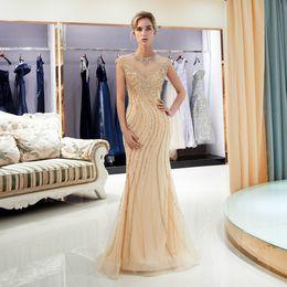 Gold Crystal Beaded Jewel Long Sleeves NZ - Gold Prom Dresses Cap Sleeves Beaded Crystal Sequined Sheer Jewel neck Mermaid Tulle See Through Back Elegant Evening Dresses Long Vestidos