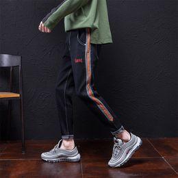 large feet 2019 - 2018 black jeans couple trousers loose autumn large size harem pants elastic men's pants four seasons stretch feet