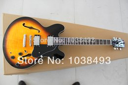 Chinese  Manufacturer to manufacture the best electric guitar 335 flower old order EMS free delivery package mail and solve difficulties manufacturers