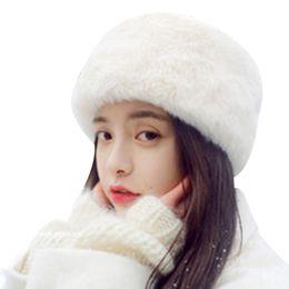 e80a2f29229 Russian Faux Fur Hat Women 2017 Winter Thick Warm Outdoor Ski Skullies  Female Casual Cossack Style Faux Fox Fur Beanies Womens