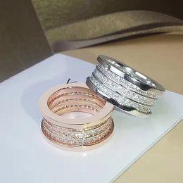 Опт весь saleBrand мода роскошные свадебные титана стали три весной полный CZ кольцо пара обручальное кольцо с логотипом и подарочной коробке