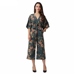 e048eeaa1d Vintage Floral V Neck Jumpsuits Wide Leg Pants Sashes Backless Pleated  Fashion Rompers Summer Casual Playsuits