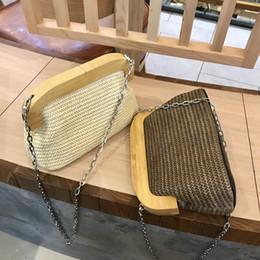 New 2018 Fashion Woven Straw Bags for women bohemia summer beach handbags  wood hasp day clutches purse chains shoulder bag 360fa5bd8560c